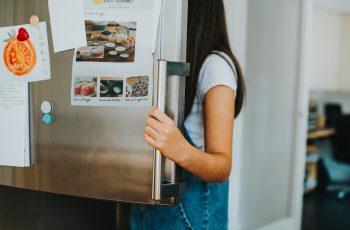 person using fridge